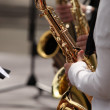 Musician and saxophone graet — Stock Photo