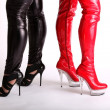 Sexy latex high heel boots in red and black - Stock Photo