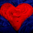 Abstract red heart on a blue background — Stock Photo