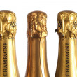 Three bottles of champagne - Stock Photo