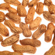 Close up of pile of peanuts on white background - Stock Photo