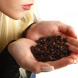 Coffee bean aroma, woman smelling coffee beans in her hands - Stock Photo