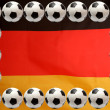 Soccer balls on German flag background - Photo