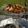 Stock Photo: Sausages on the grill