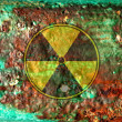 Radiation sign on rusty metal background - Stock Photo