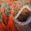 Pile red fishing net background - Stock Photo