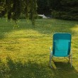 Stock Photo: Simple chaise lounge on green grass