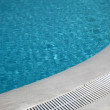 Hotel swimming pool with sunny reflections — Stock Photo #16514227