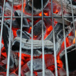 closeup of charcoal burning under a barbecue grill — Stock Photo