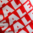 A poster with the word Sale - Stock Photo