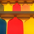 Shelf with bottles  colored — Stok fotoğraf