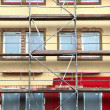 Scaffolds round an  building - 图库照片