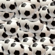 Multiplied soccer balls — Stock Photo