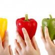 Three juicy, ripe peppers kept in women — Stock Photo