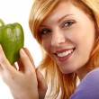 Stock Photo: Young beauty with a green paprika . white background