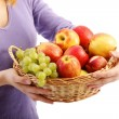 Beautiful woman with a fruit basket.white background - Stock Photo