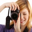 Young beautiful woman with a camera  — Stock Photo