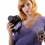 She holds single-lens reflex camera and compact camera — Stock Photo #16518069