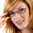 Young woman with eyeglasses - Stock Photo
