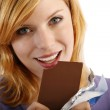 Blond woman with a block of chocolate. white background — Stock Photo