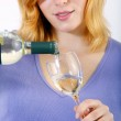 Woman with a bottle wine and a wineglass — Stock Photo