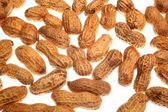 Nahaufnahme des Haufen Erdnüsse auf weißem Hintergrund — Stockfoto