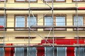 Scaffolds round an building — Stock Photo