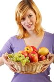 Beautiful woman with a fruit basket.white background — Stock Photo