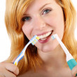 Stock Photo: Young wombrushing teeth