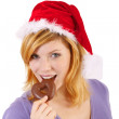 Stock Photo: Young woman with santa hat and gingerbread (white background)