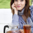 Young woman and tea - Stock Photo