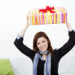 Young woman with a packed gift - Stock Photo
