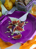 Figs, Camambert, Pears, Honey, Crisps And Pine Nuts On Purple Dish — Stock Photo
