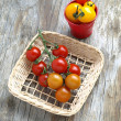 Yellow And Red Cherry Tomatoes In The Basket Aand Red Bucket On The Rustic Wooden Table — Stock Photo