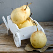 Pears In The Lace Basket — Stock Photo