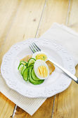 Smoked squid, hard boiled egg, spiral cucumber — Stock Photo