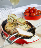 Pork Roast In The Red Ceramic Baking Dish, Cherry Tomatoes — Stock Photo