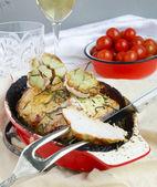Pork Roast In The Red Ceramic Baking Dish, Cherry Tomatoes — Stock Photo