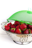 Strawberries in the colander — Stock Photo
