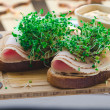 Bread with smoked turkey ham, broccoli sprouts and mustard — Stock Photo