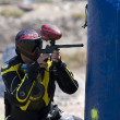 Paintball player in action - Stock Photo