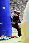 Paintball player in action — Stock Photo