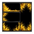 Fire on a black background — Stock Vector