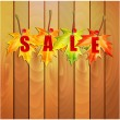 Yellow maple leaves and the word sale on the wooden wall.illus — Stock Vector