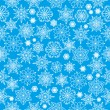 Seamless pattern with white snowflakes on a blue background.wint — Stock Vector