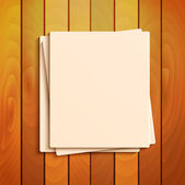 Blank sheets of paper on the background a wooden surface.station — 图库矢量图片