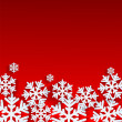 Christmas background.White snowflakes on red background.backgrou — Stock Vector