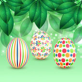 Easter eggs with colorful patterns on a background of spring fol — Vector de stock