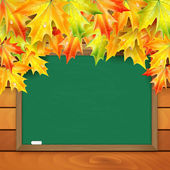 School board and autumn maple leaves on a background of a wooden — Stock Vector