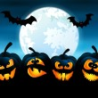 Halloween night with pumpkins — Stock Vector #32200813